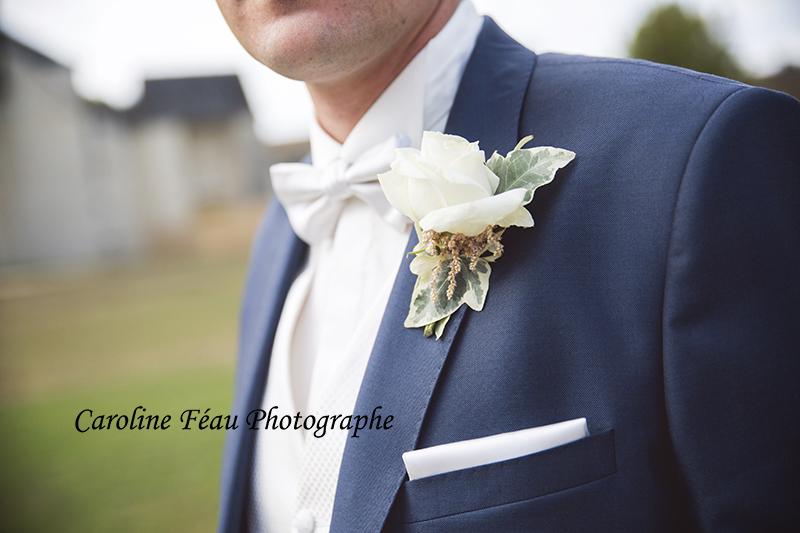 Boutonnière du marié 49 37 72 CF Photographe