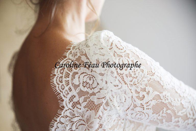 détail robe de la mariée dentelle CF Photographe